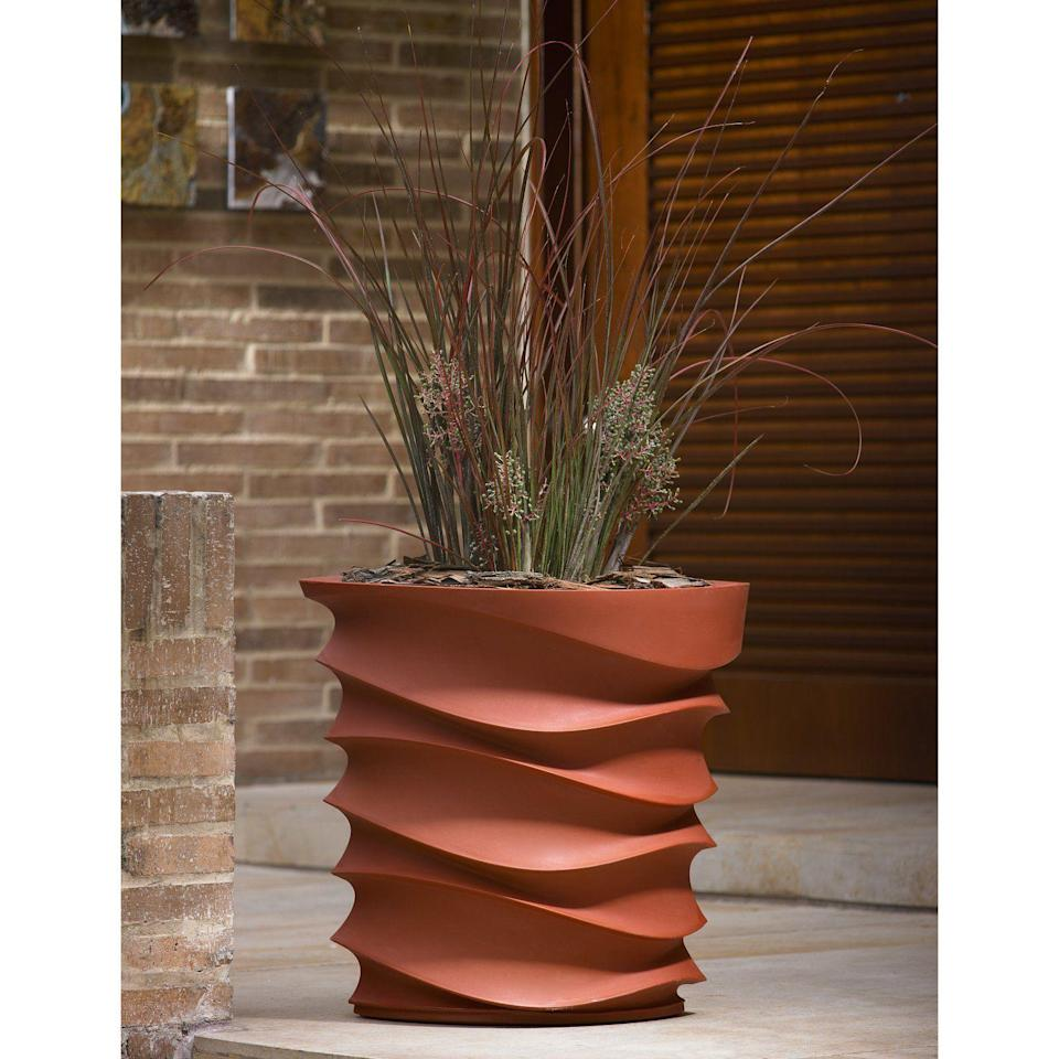 """<p><strong>Crescent Garden</strong></p><p>hayneedle.com</p><p><strong>$206.00</strong></p><p><a href=""""https://www.hayneedle.com/product/roundresineyeam26inchplanter.cfm"""" rel=""""nofollow noopener"""" target=""""_blank"""" data-ylk=""""slk:Shop Now"""" class=""""link rapid-noclick-resp"""">Shop Now</a></p><p>For a planter that's more on the elegant side, look no further than this wave-like design, available in copper (<em>shown here</em>), white, and black. <br></p>"""