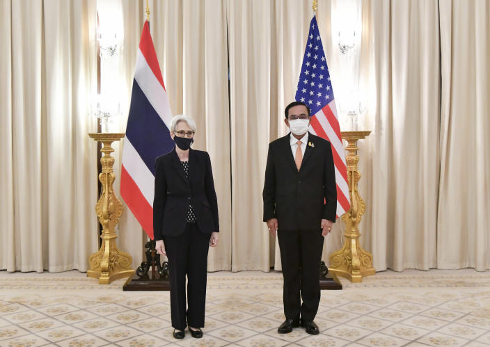 In this photo released by Government Spokesman Office, U.S. Deputy Secretary of State Wendy R. Sherman, left, and Thailand's Prime Minister Prayuth Chan-ocha, right, pose for photo, at Government House in Bangkok, Thailand, Wednesday, June 2, 2021. (Government Spokesman Office via AP)