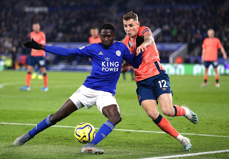 Leicester City's Wilfred Ndidi and Everton's Lucas Digne battle for the ball. (Credit: Getty Images)