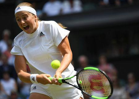 Tennis - Wimbledon - All England Lawn Tennis and Croquet Club, London, Britain - July 12, 2018. Latvia's Jelena Ostapenko in action during her semi final match against Germany's Angelique Kerber. Neil Hall/pool via Reuters