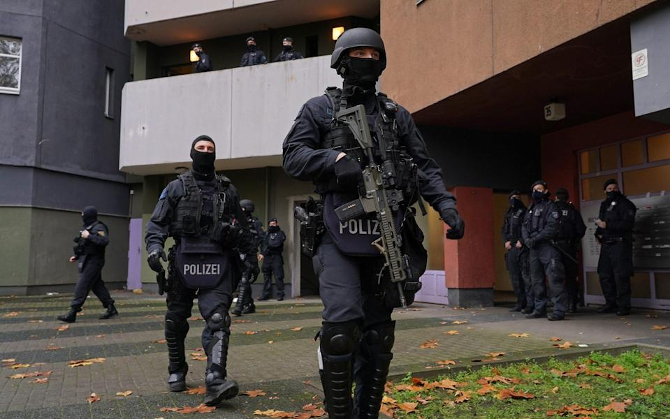 Heavily armed police take part in a raid on the Remmo Clan in Berlin this week - Sean Gallup/Getty Images Europe