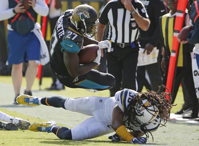 <p>Los Angeles Chargers safety Tre Boston (33) upends Jacksonville Jaguars running back Leonard Fournette (27) after a short gain during the first half of an NFL football game, Sunday, Nov. 12, 2017, in Jacksonville, Fla. (AP Photo/Stephen B. Morton) </p>