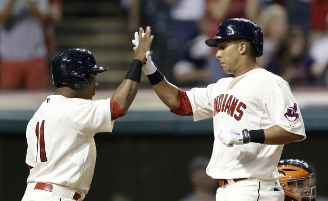 Cleveland Indians' Michael Brantley, right, is congratulated by Jose Ramirez after Brantley hit a two-run home run off Baltimore Orioles starting pitcher Ubaldo Jimenez in the fifth inning of a baseball game, Saturday, Aug. 16, 2014, in Cleveland. Ramirez scored on the play. (AP Photo/Tony Dejak)