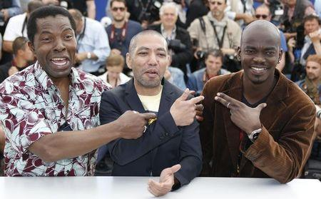 "Director Philippe Lacote, cast member Isaach De Bankole and actor Abdoul Karim Konate pose during a photocall for the film ""Run"" in competition for the category ""Un Certain Regard"" at the 67th Cannes Film Festival in Cannes"