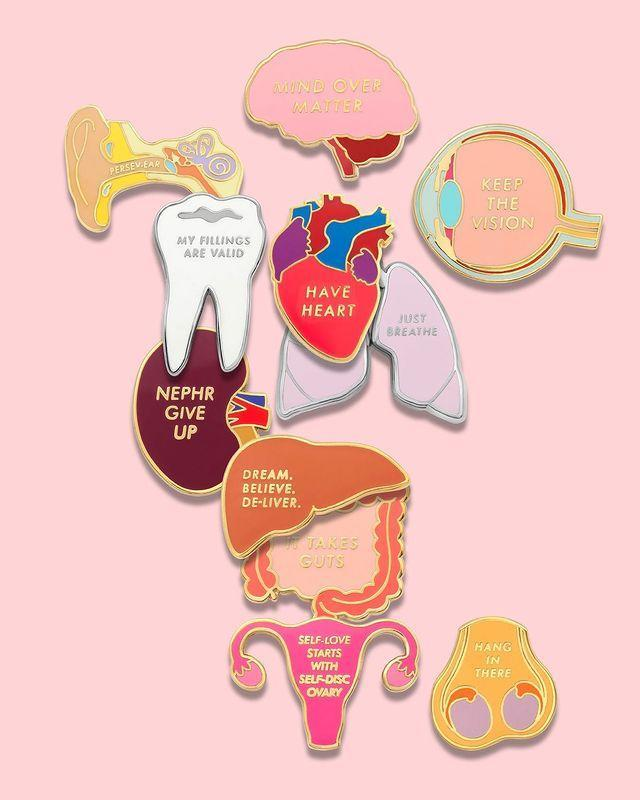 """<p>There is definitely a doctor, nurse, dentist, pharmacist, teacher or vet in your life who'd love one of the cheeky enamel pins or jewelry charms created by Dr. Lynna Van Merkey, the dentist who decided everyone's scrubs needed a little cheeky style. </p> <p><strong>Buy It! </strong>V Coterie enamel pins, $10 and up; <a href=""""https://vcoterie.com/"""" rel=""""nofollow noopener"""" target=""""_blank"""" data-ylk=""""slk:vcoterie.com"""" class=""""link rapid-noclick-resp"""">vcoterie.com</a></p>"""