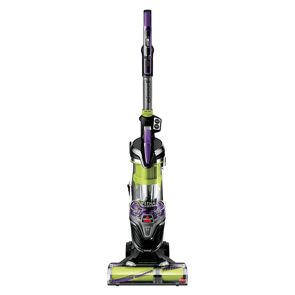 """<p><strong>BISSELL</strong></p> <p><strong>$129.99</strong></p><p><a href=""""https://www.amazon.com/BISSELL-Lightweight-Upright-Cleaner-24613/dp/B07QXTS4KH/?tag=syn-yahoo-20&ascsubtag=%5Bartid%7C2139.g.35311665%5Bsrc%7Cyahoo-us"""" rel=""""nofollow noopener"""" target=""""_blank"""" data-ylk=""""slk:BUY IT HERE"""" class=""""link rapid-noclick-resp"""">BUY IT HERE</a></p><p>A moderately priced option with over 4,000 near-perfect reviews on Amazon is the BISSELL Pet Hair Eraser Turbo Plus. While it appears to be clunkier than the rest, it's pretty compact when it comes to upright vacuums with a ton of added features. With an extended reach tool for hard-to-reach surfaces and a 2-in-1 pet dusting brush, no particle will be left behind.</p>"""