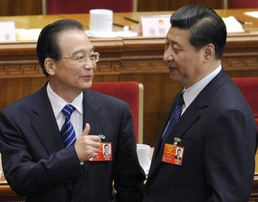 This file photo, taken in March, shows Chinese Premier Wen Jiabao (L) talking to Vice President Xi Jinping after the fourth plenary meeting of the National People's Congress's (NPC) annual session at the Great Hall of the People in Beijing