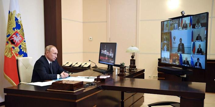 Russian President Vladimir Putin chairs a meeting via teleconference call at the Novo-Ogaryovo state residence outside Moscow on August 11, 2020.
