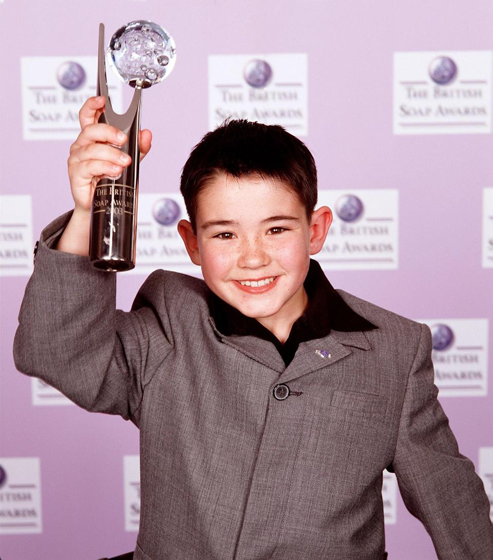 Jack McMullen in 2003, holding his British Soap award for Best Newcomer (ITV/Shutterstock)