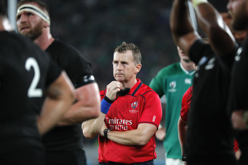 Referee Nigel Owens gestures during the Rugby World Cup quarterfinal match at Tokyo Stadium between New Zealand and Ireland in Tokyo, Japan, Saturday, Oct. 19, 2019. (AP Photo/Eugene Hoshiko)
