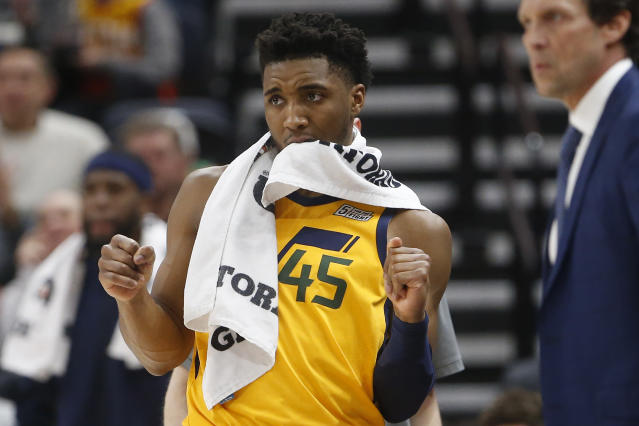 Utah Jazz guard Donovan Mitchell (45) reacts as he watches from the bench during the second half of an NBA basketball game against the San Antonio Spurs on Friday, Feb. 21, 2020, in Salt Lake City. (AP Photo/Rick Bowmer)
