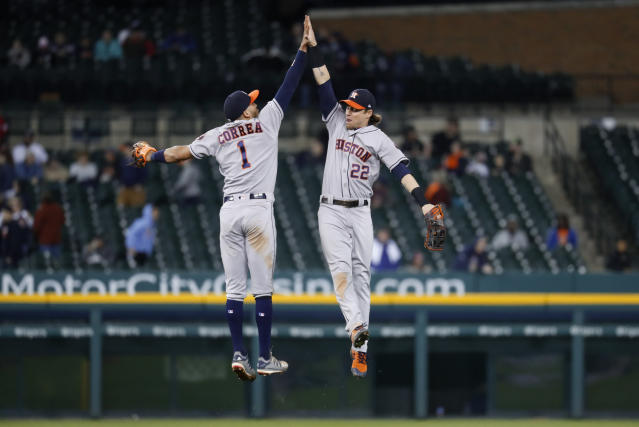 Houston Astros' Carlos Correa (1) and Josh Reddick (22) celebrate the team's 11-4 win in a baseball game against the Detroit Tigers in Detroit, Tuesday, May 14, 2019. (AP Photo/Paul Sancya)