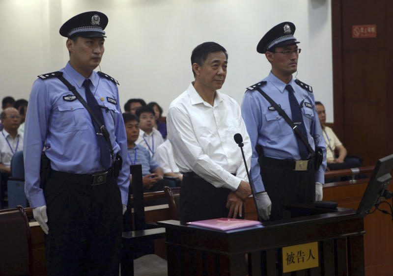 FILE - In this file photo taken Thursday Aug. 22, 2013 and released by the Jinan Intermediate People's Court, Bo Xilai, center, stands on trial at the court in eastern China's Shandong province. The Jinan Intermediate Court released a surprising amount of details from Bo's trial, issuing regular microblog posts and same-day transcripts that included testimony, cross-examination, details of evidence and defense statements. But the partial openness is less a sign of legal reform than of the leadership's desire to lend credibility to a process believed to have a foregone conclusion: a lengthy jail sentence for Bo for dragging the ruling Communist Party into a lurid scandal of corruption, murder and betrayal. (AP Photo/Jinan Intermediate People's Court, File)