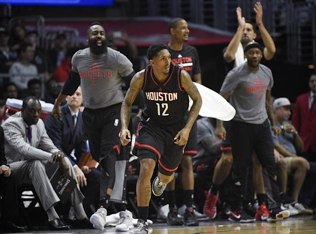 James Harden and the Rockets' bench cheer on Lou Williams. (AP)