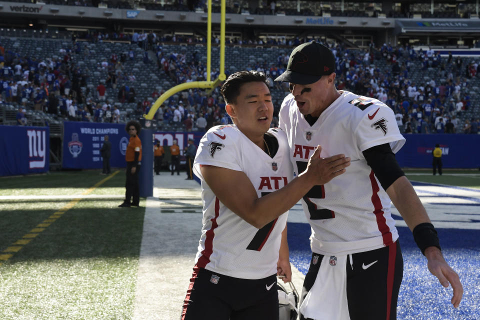 Atlanta Falcons kicker Younghoe Koo, left, and quarterback Matt Ryan, right, celebrate after their win over the New York Giants after an NFL football game, Sunday, Sept. 26, 2021, in East Rutherford, N.J. (AP Photo/Bill Kostroun)