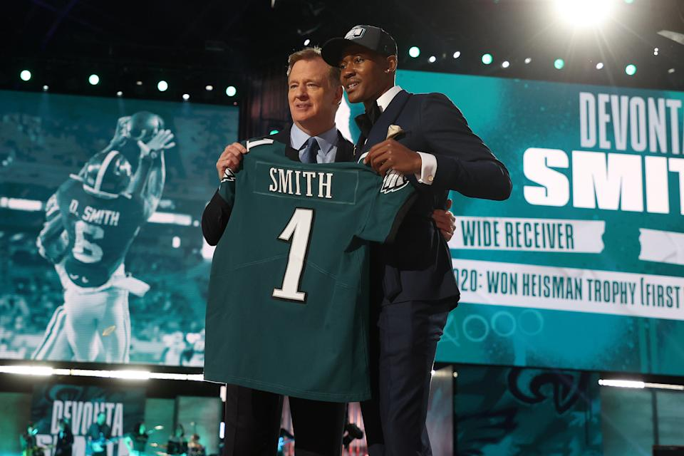 CLEVELAND, OHIO - APRIL 29: DeVonta Smith poses with NFL Commissioner Roger Goodell onstage after being selected 10th by the Philadelphia Eagles during round one of the 2021 NFL Draft at the Great Lakes Science Center on April 29, 2021 in Cleveland, Ohio. (Photo by Gregory Shamus/Getty Images)