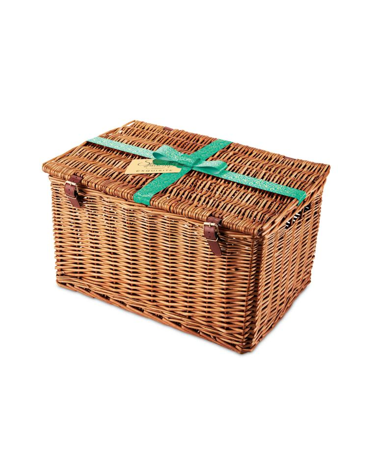 <p>The goodies in the Exquisite hamper are packed into a traditional wicker basket. Also inside, shoppers will find three kinds of cracker, a panettone cake, a Christmas cake and some luxury chocolates. </p>