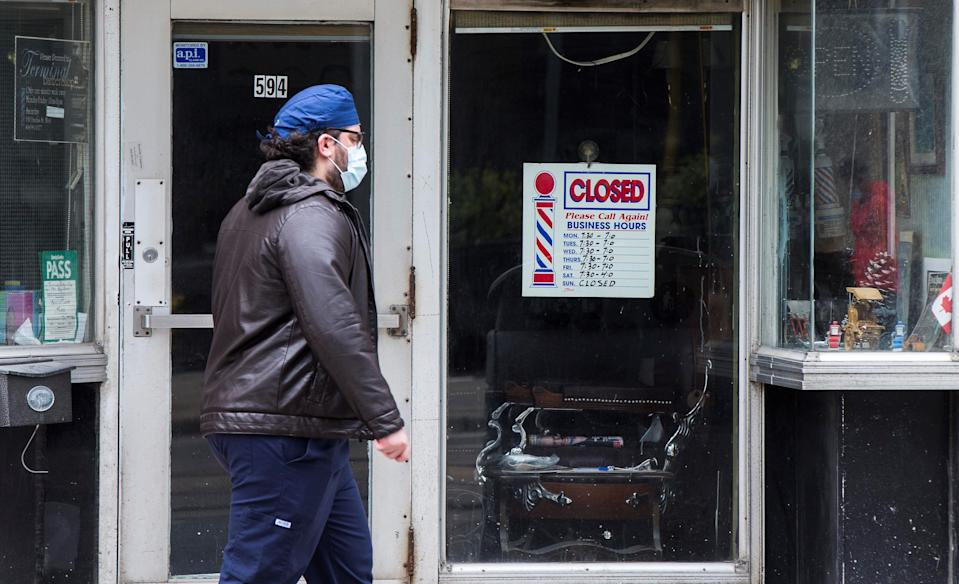 A man wearing a face mask walks past a closed hair salon in Toronto, Canada, on May 7, 2021. The Canadian unemployment rate rose 0.6 percentage point to 8.1 percent in April from March 2021 as public health measures against the COVID-19 pandemic were tightened, according to Statistics Canada on Friday. (Photo by Zou Zheng/Xinhua via Getty Images) (Xinhua/Zou Zheng via Getty Images)