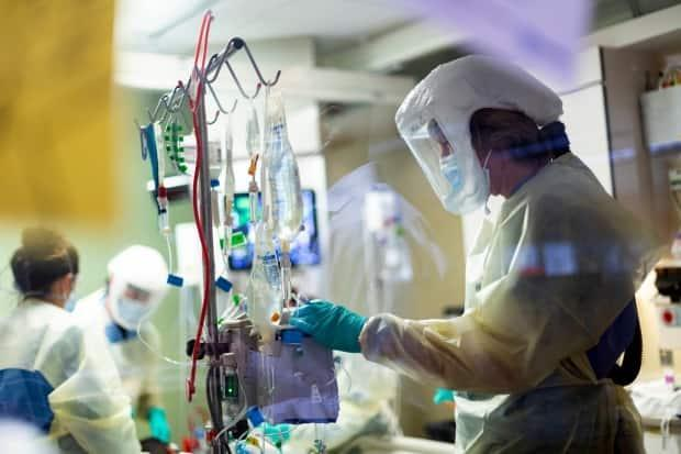 Saskatchewan health officials recorded 356 people in hospital with COVID-19 on Wednesday — 76 of them under intensive care, breaking the province's previous record set just the day before. (Kyle Green/The Associated Press - image credit)