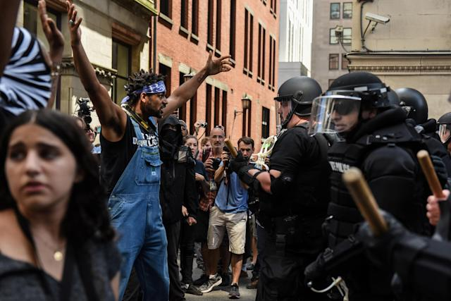 <p>A counter protester reacts during clashes with Boston Police outside of the Boston Commons and the Boston Free Speech Rally in Boston, Mass., Aug. 19, 2017. (Photo: Stephanie Keith/Reuters) </p>