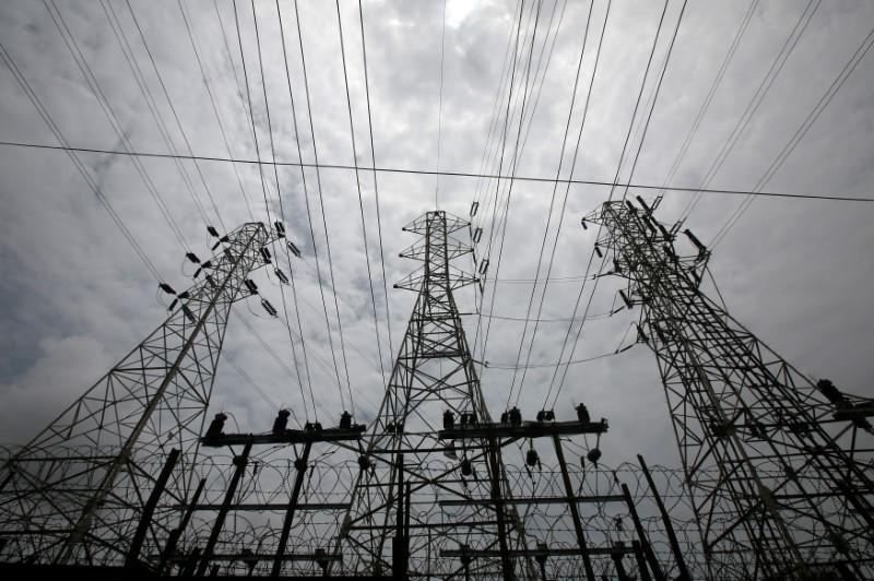High-tension power lines are pictured outside a Tata Power sub station in the suburbs of Mumbai