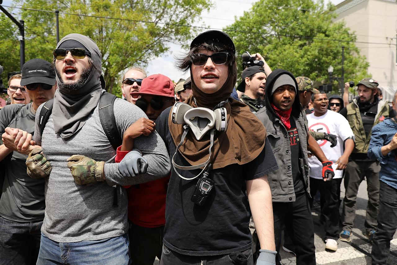 <p>NEWNAN, GA – APRIL 21: Anti racist protesters encounter members and supporters of the National Socialist Movement, one of the largest neo-Nazi groups in the US, as they prepare to hold a rally on April 21, 2018 in Newnan, Georgia. Community members have opposed the rally and have come out to embrace racial unity in the small Georgia town. Fearing a repeat of the violence that broke out after Charlottesville, hundreds of police officers are stationed in the town during the rally in an attempt to keep the anti racist protesters and neo-Nazi groups separated. (Photo by Spencer Platt/Getty Images) </p>