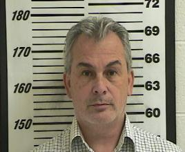 FILE PHOTO: Michael Taylor, who was implicated in enabling the dramatic escape of former Nissan Motor Co boss Carlos Ghosn, is seen in a booking photograph from October 24, 2012