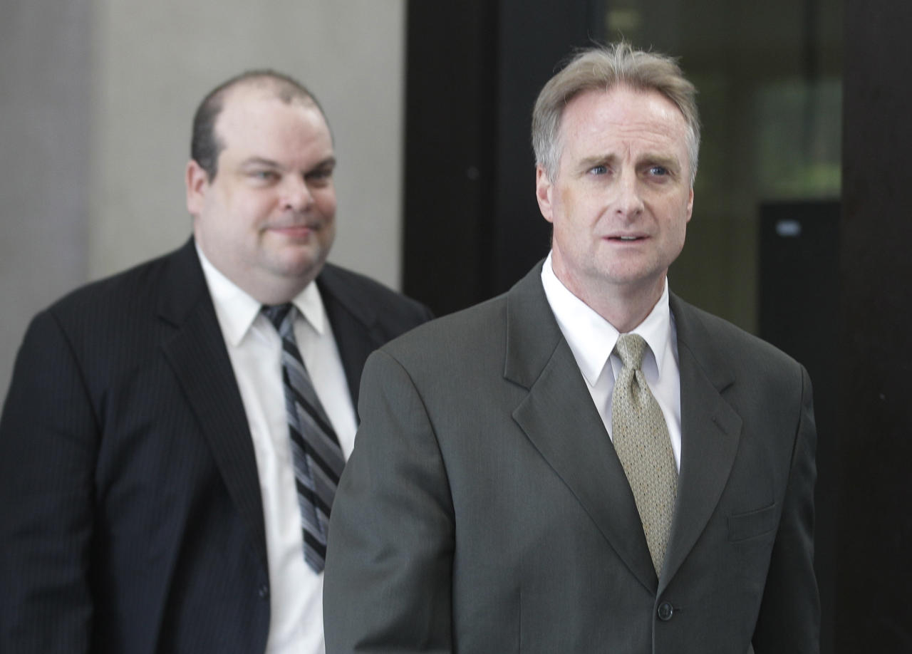 James McKay, right, prosecutor in the William Balfour murder trial, leaves court Friday, May 11, 2012, in Chicago after Balfour was convicted of murdering the mother, brother and nephew of singer and actress Jennifer Hudson. Balfour faces a mandatory life prison sentence. (AP Photo/M. Spencer Green)
