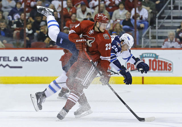 Phoenix Coyotes defenseman Oliver Ekman-Larsson (23) and Winnipeg Jets right wing Blake Wheeler (26) collide at center ice during the second period of an NHL hockey game Tuesday, April 1, 2014, in Glendale, Ariz. (AP Photo/The Arizona Republic, David Kadlubowski)