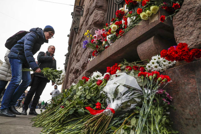 <p>A man lays flowers at a symbolic memorial outside the Tekhnologichesky Institute subway station in St. Petersburg, Russia, Tuesday, April 4, 2017. A bomb blast tore through a subway train deep under Russia's second-largest city St. Petersburg Monday, killing several people and wounding many more in a chaotic scene that left victims sprawled on a smoky platform. (Dmitri Lovetsky/AP) </p>