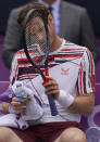 Andy Murray of Britain holds his racket during a break as he plays Matteo Berrettini of Italy during their singles tennis match at the Queen's Club tournament in London, Thursday, June 17, 2021. (AP Photo/Kirsty Wigglesworth)