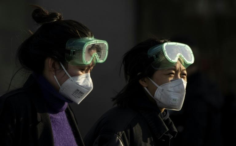 Neighbours are being encouraged to report on each other as the Chinese government seeks to halt the spread of the coronavirus (AFP Photo/NOEL CELIS)