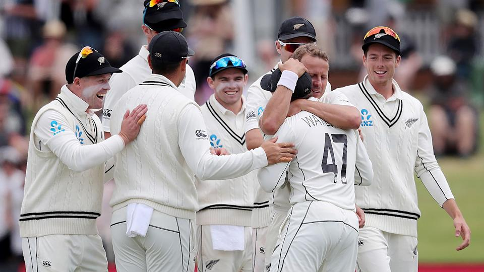 New Zealand celebrate after defeating Pakistan in the second Test of their four-match series. (Photo by MICHAEL BRADLEY / AFP) (Photo by MICHAEL BRADLEY/AFP via Getty Images)