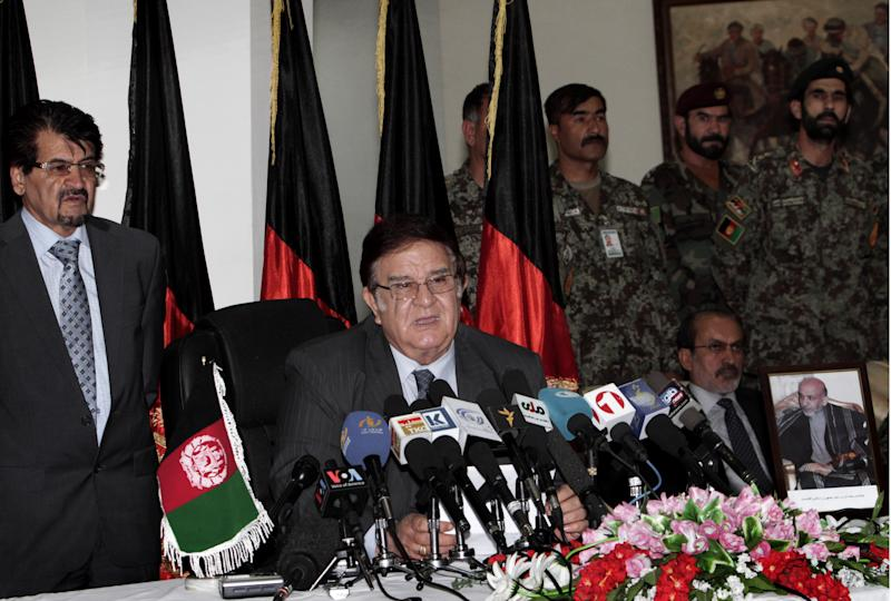 Afghan Defense Minister Abdul Rahim Wardak, center, speaks during a press conference in Kabul, Afghanistan, Tuesday, Aug. 7, 2012. Wardak says he is stepping down, just days after receiving a no-confidence vote from parliament. (AP Photo/Musadeq Sadeq)