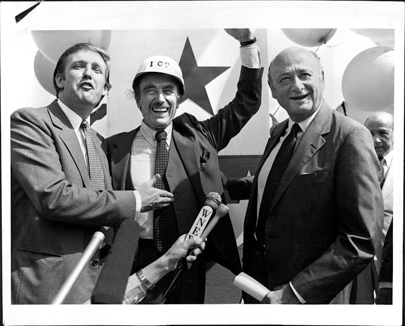 Donald Trump, his father, Fred, and New York Mayor Ed Koch celebrate the completion of Trump Tower in July 1982.