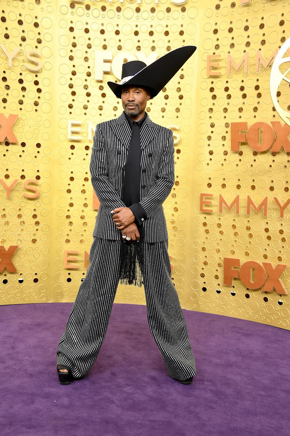 'Pose' star Billy Porter brought his signature style to the Emmys purple carpet in custom Michael Kors. [Photo: Getty]