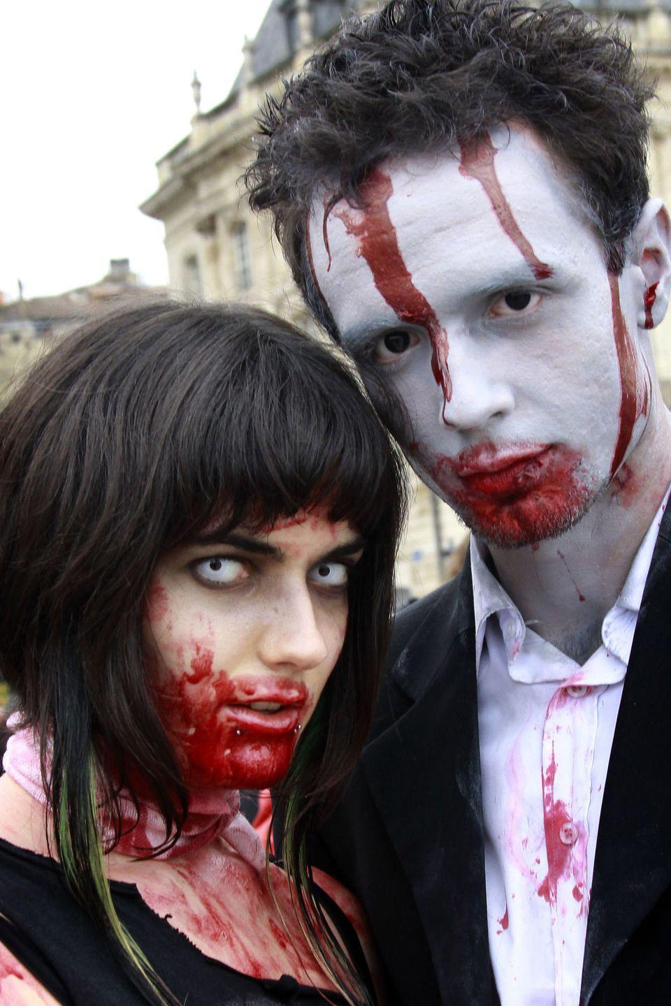"""<p>Turn yourselves into <em>The Walking Dead</em> extras with a little makeup and lots of fake blood (which you can buy or <a href=""""https://www.goodhousekeeping.com/holidays/halloween-ideas/how-to/a35075/how-to-make-fake-blood/"""" rel=""""nofollow noopener"""" target=""""_blank"""" data-ylk=""""slk:make at home"""" class=""""link rapid-noclick-resp"""">make at home</a>). Then go the extra mile with colored contacts.</p><p><a class=""""link rapid-noclick-resp"""" href=""""https://www.amazon.com/dp/B06XC7TVGT/?tag=syn-yahoo-20&ascsubtag=%5Bartid%7C10055.g.2625%5Bsrc%7Cyahoo-us"""" rel=""""nofollow noopener"""" target=""""_blank"""" data-ylk=""""slk:SHOP FAKE BLOOD"""">SHOP FAKE BLOOD</a></p>"""