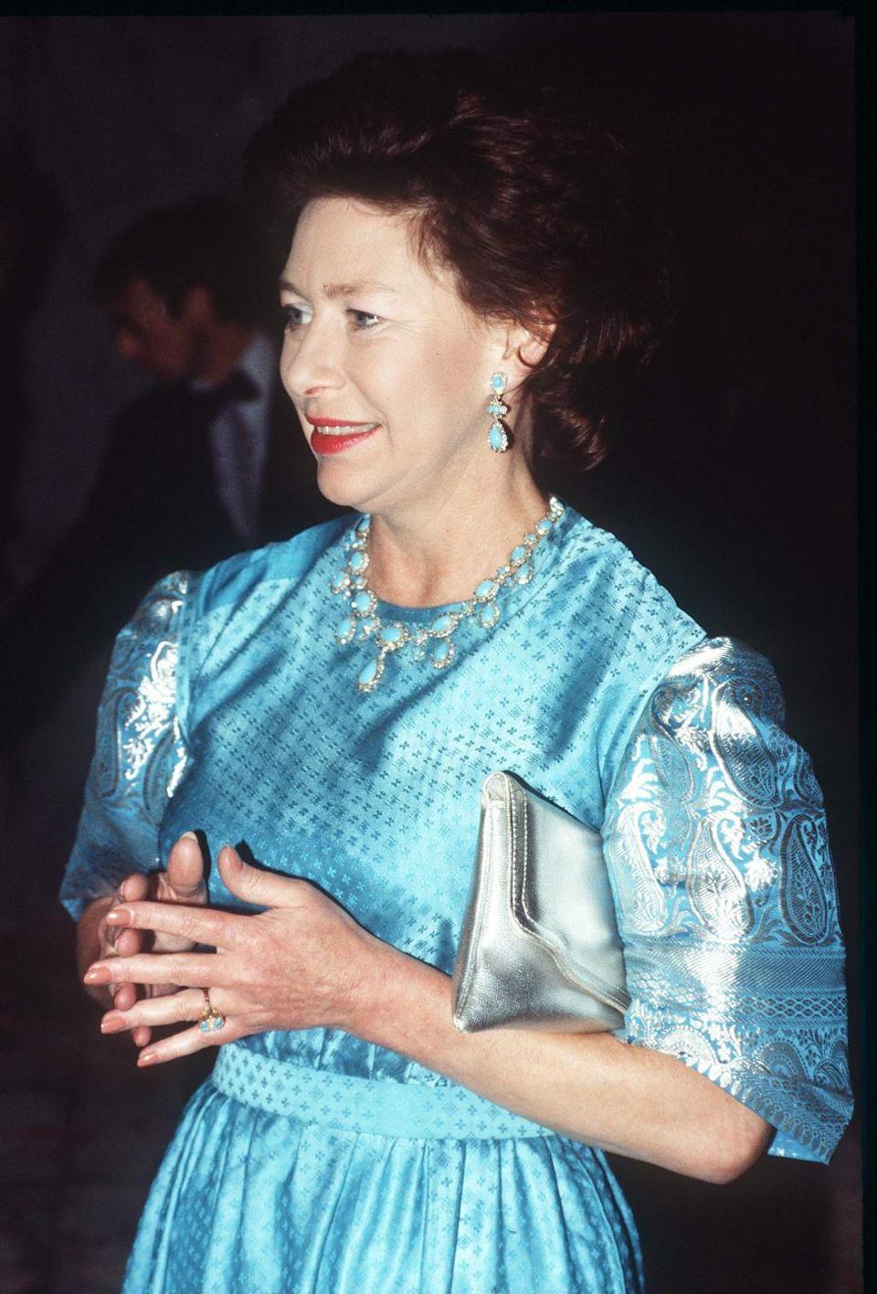 "<p>Princess Margaret was bequeathed an exquisite, Garrard-made set of <a href=""https://www.townandcountrymag.com/style/jewelry-and-watches/a20723522/princess-margaret-triumph-of-love-tiara/"" rel=""nofollow noopener"" target=""_blank"" data-ylk=""slk:Persian turquoise pieces"" class=""link rapid-noclick-resp"">Persian turquoise pieces</a> from the Queen Mother, who in turn received them as a wedding gift from her father-in-law King George V. Sadly, the parure—which includes a necklace, earrings, tiara, brooch—hasn't been seen since Margaret's death, and it isn't clear if it is now in the possession of one of her children, or has been returned to the royal vaults. Only time will tell!</p>"