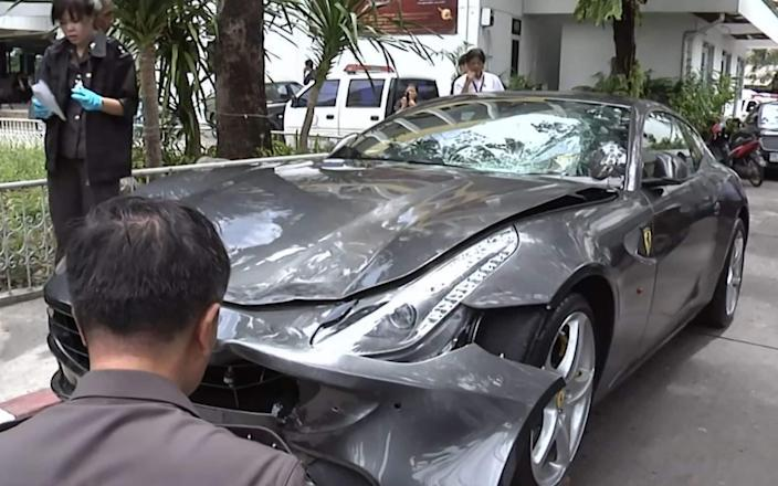 Police inspecting the Ferrari belonging to Red Bull heir Vorayuth 'Boss' Yoovidhya in Bangkok - AFP