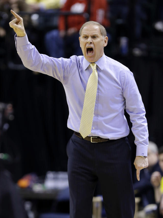 Michigan head coach John Beilein directs his team in the first half of an NCAA college basketball game against Ohio State in the semifinals of the Big Ten Conference tournament Saturday, March 15, 2014, in Indianapolis. (AP Photo/Michael Conroy)