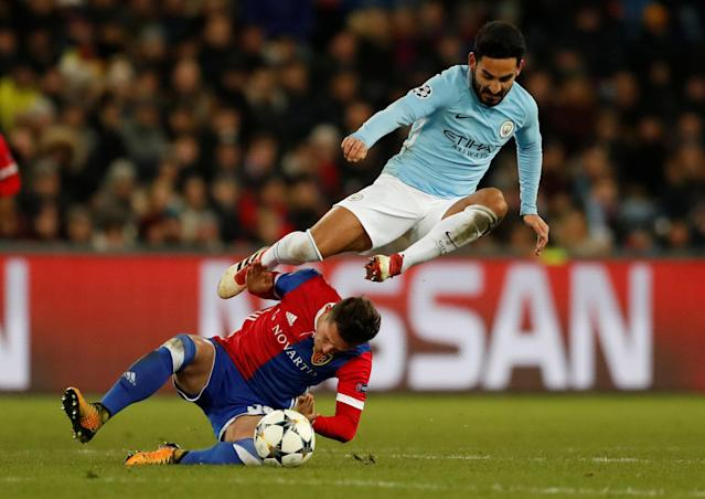 Soccer Football - Champions League - Basel vs Manchester City - St. Jakob-Park, Basel, Switzerland - February 13, 2018 Manchester City's Ilkay Gundogan in action with Basel's Taulant Xhaka Action Images via Reuters/Andrew Boyers