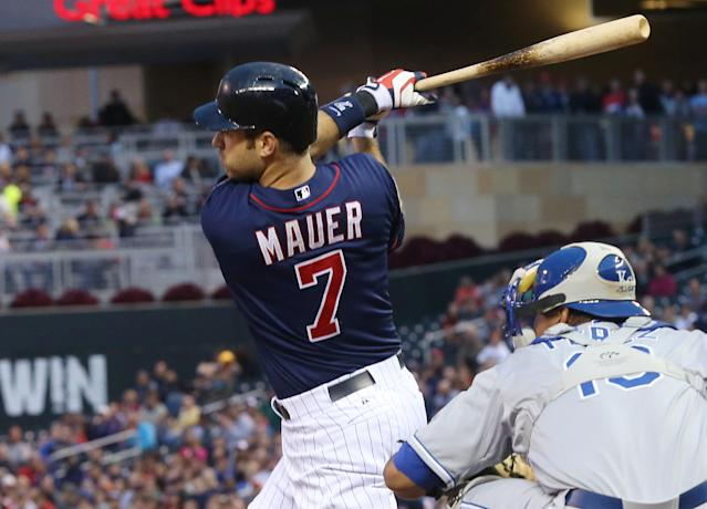 Minnesota Twins' Joe Mauer watches his two-run double off Kansas City Royals pitcher James Shields in the fourth inning of a baseball game, Tuesday, July 1, 2014, in Minneapolis. (AP Photo/Jim Mone)