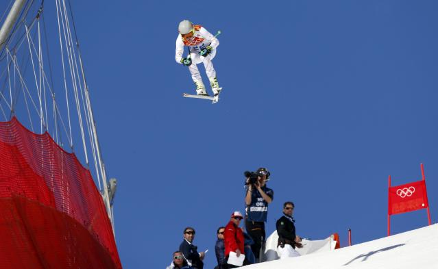 Ted Ligety of the U.S. competes in the downhill run of the men's alpine skiing super combined event at the 2014 Sochi Winter Olympics, February 14, 2014. REUTERS/Stefano Rellandini (RUSSIA - Tags: OLYMPICS SPORT SKIING)