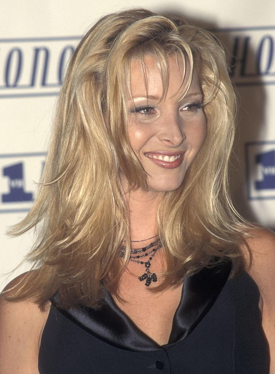 """<p>Lisa Kudrow was 31 years old when she made her debut as Phoebe Buffay in <strong>Friends</strong>, which makes her the eldest of her cast mates. Soon after the first season aired, Kudrow married her husband Michel Stern. When Kudrow announced she and Michel were expecting, the producers wrote her pregnancy into the script for season four. </p> <p>""""The six of us would do a huddle backstage and just say, 'All right, have a good show, love you love you love you love you.' And when I was pregnant, then they would say, 'Have a great show, love you love you - love you, little Julian!' Cause we knew it was a boy and that was his name. So sweet, <a href=""""http://people.com/parents/lisa-kudrow-son-julian-graduates-university-southern-california/"""" class=""""link rapid-noclick-resp"""" rel=""""nofollow noopener"""" target=""""_blank"""" data-ylk=""""slk:they included my little fetus in the huddle"""">they included my little fetus in the huddle</a>,"""" she told <strong>People</strong> in 2018. In 1998, she won a Primetime Emmy for Outstanding Supporting Actress in a Comedy Series and a SAG award for Outstanding Performance by a Female Actor in a Comedy Series in 2000 for her role of Phoebe.<br></p>"""