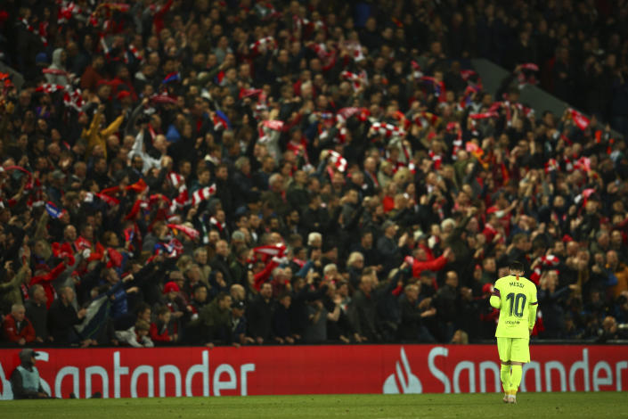 Barcelona's Lionel Messi walks as Liverpool's Divock Origi celebrates scoring his side's 4th goal during the Champions League semifinal, second leg, soccer match between Liverpool and FC Barcelona at the Anfield stadium in Liverpool, England, Tuesday, May 7, 2019. (AP Photo/Dave Thompson)