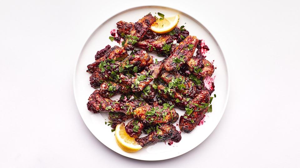 """Turn your bag of frozen berries into a sour-sweet sauce for crispy wings. <a href=""""https://www.bonappetit.com/recipe/grilled-chicken-wings-with-summer-berry-agrodolce?mbid=synd_yahoo_rss"""" rel=""""nofollow noopener"""" target=""""_blank"""" data-ylk=""""slk:See recipe."""" class=""""link rapid-noclick-resp"""">See recipe.</a>"""