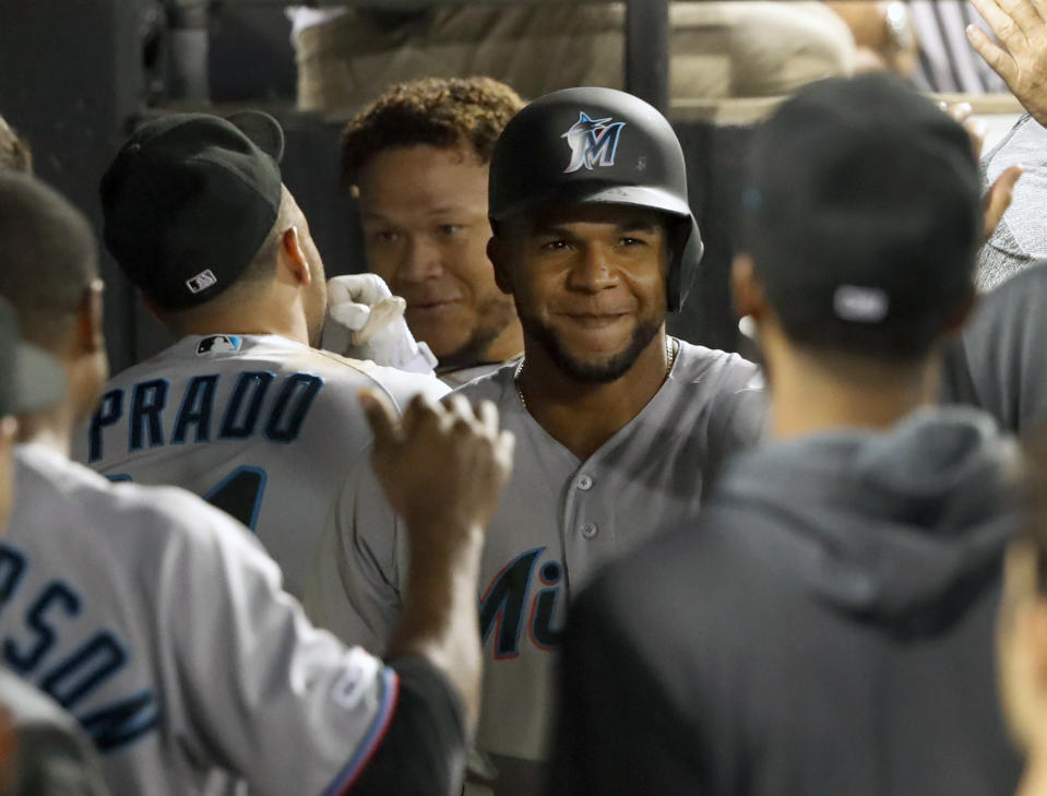 Miami Marlins' Cesar Puello celebrates in the dugout his two-run home run off Chicago White Sox starting pitcher Reynaldo Lopez during the eighth inning of a baseball game Wednesday, July 24, 2019, in Chicago. Harold Ramirez also scored. (AP Photo/Charles Rex Arbogast)