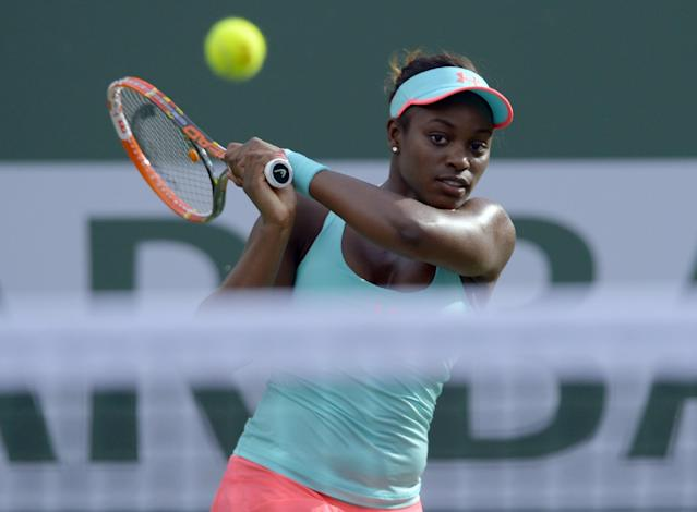 Sloane Stephens hits to Flavia Pennetta, of Italy, during a quarterfinal match at the BNP Paribas Open tennis tournament Thursday, March 13, 2014, in Indian Wells, Calif. (AP Photo/Mark J. Terrill)