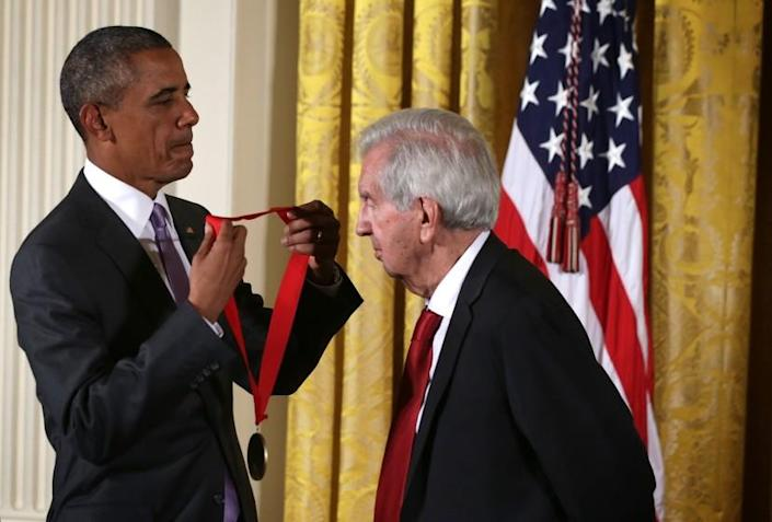 WASHINGTON, DC - SEPTEMBER 10: U.S. President Barack Obama (L) presents the 2014 National Humanities Medal to Larry McMurtry during an East Room ceremony at the White House September 10, 2015 in Washington, DC. Larry McMurtry was honored for his books, essays, and screenplays. (Photo by Alex Wong/Getty Images)