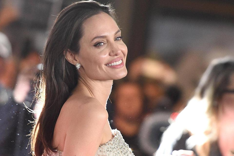 <p>Ms Jolie and William Hague launched a campaign against sexual violence in conflict in 2012  </p> (Getty)